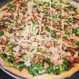 Caesar Salad Pizza from Mo'Nelisa Italian Restaurant and Pizzeria in Point Lookout New York